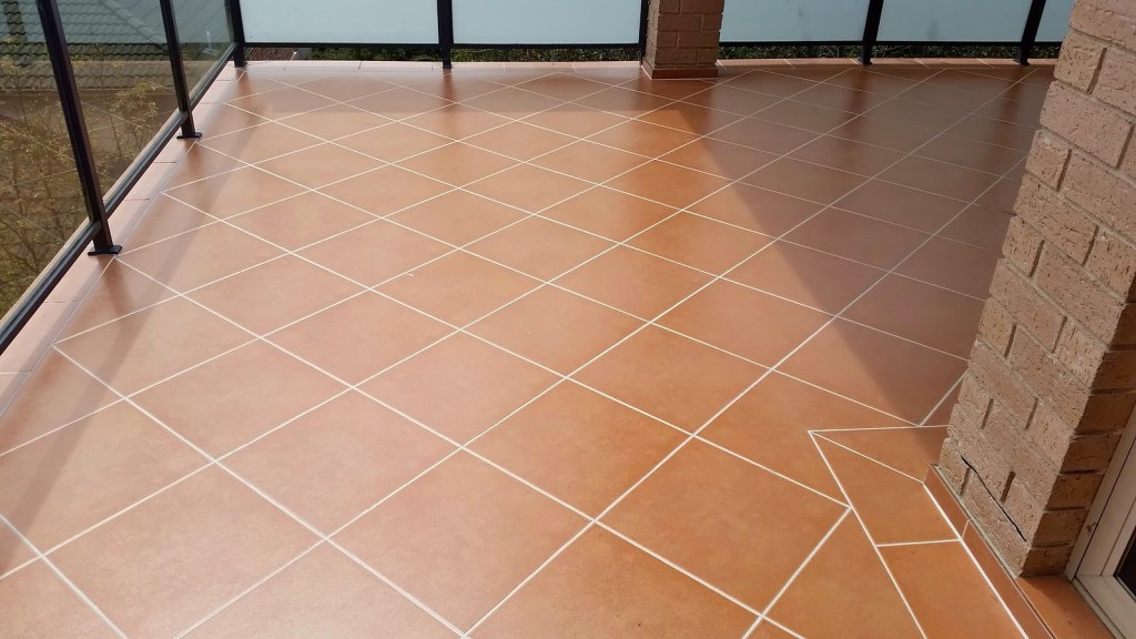 Ceramic tiled balcony reseal and epoxy regrout.