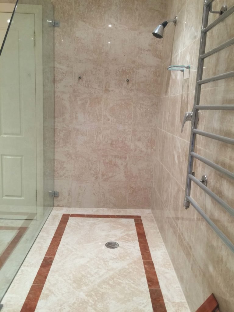 Travertine tiles shower leaking 2/14